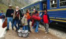 Cuzco, Peru, family traveling by train