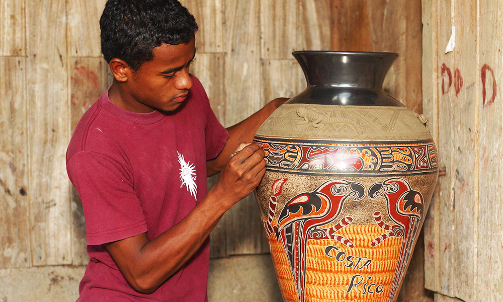 Teen artisan working on pottery in Costa Rica