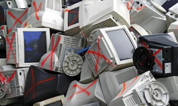 Discarded obsolete computer monitor and equipment being processed for recycle