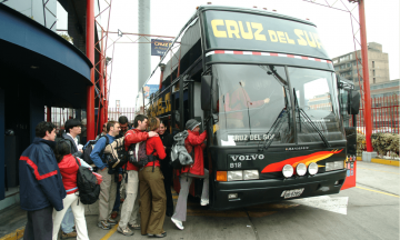 People getting on bus in Lima, Peru