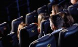 Group of people watching movie at the cinema