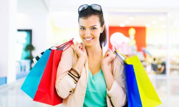 Woman in shopping mall with shopping bags