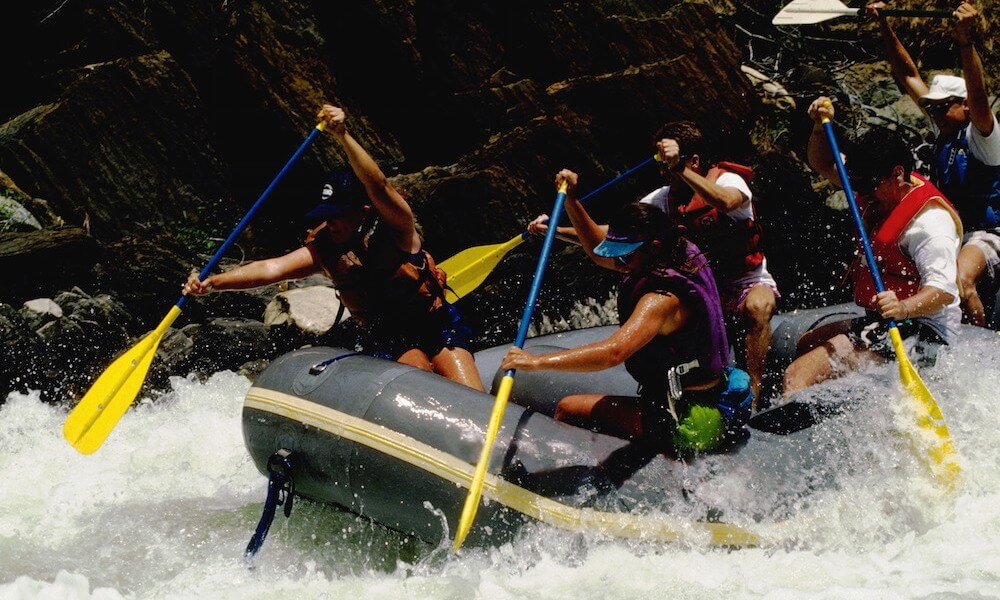 Whitewater Rafters Shooting a Rapid