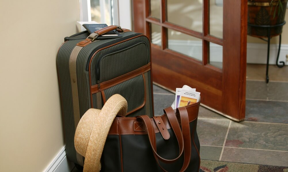 Luggage and purse by doorway