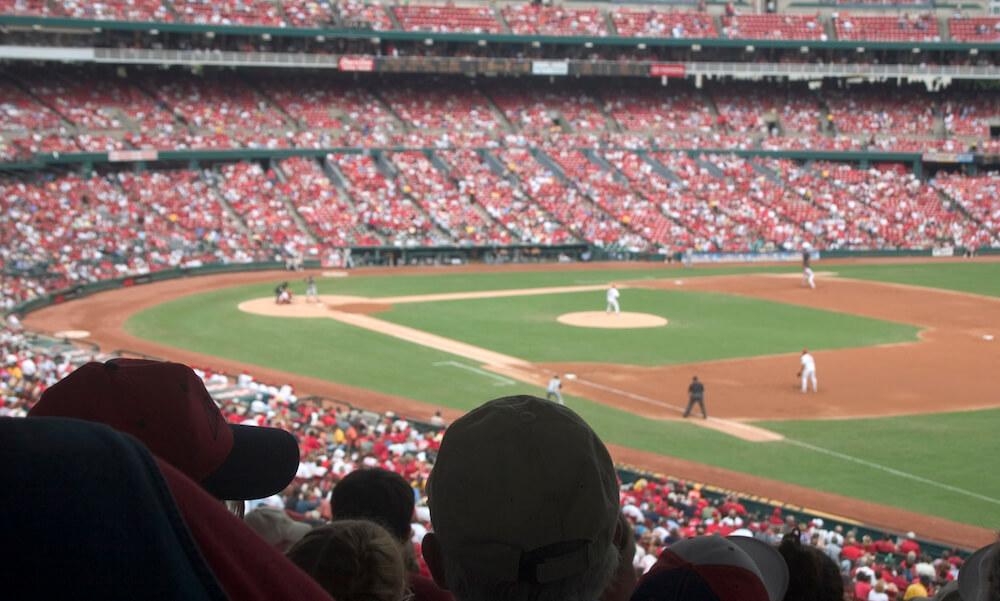 Huge stadium crowd watching a baseball game