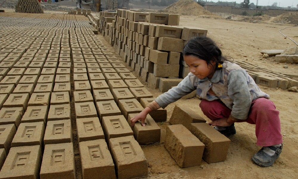 A child laborer works with bricks circa August 2007 in Peru.