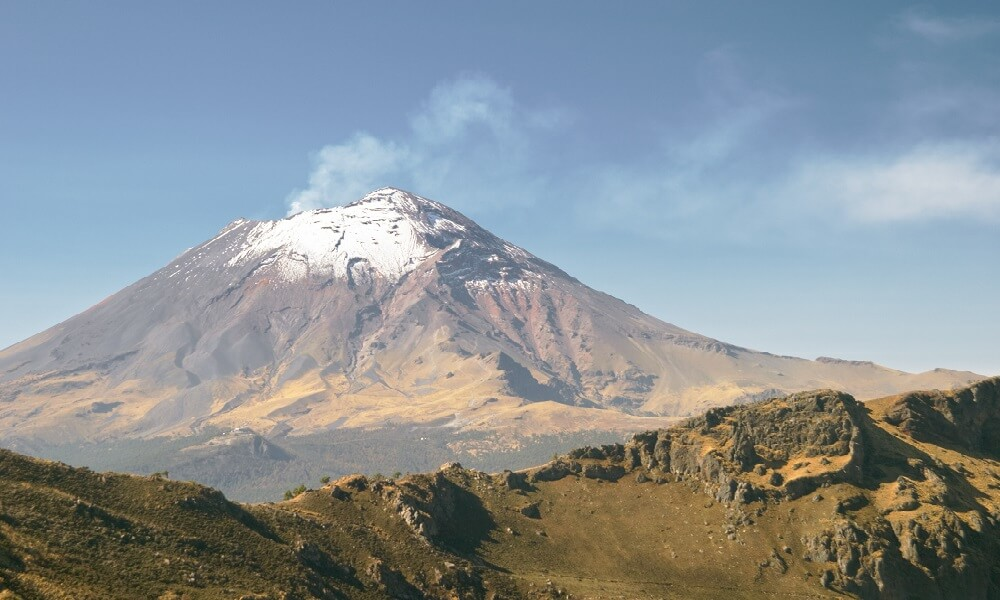 Active snowcapped Popocatepetl volcano