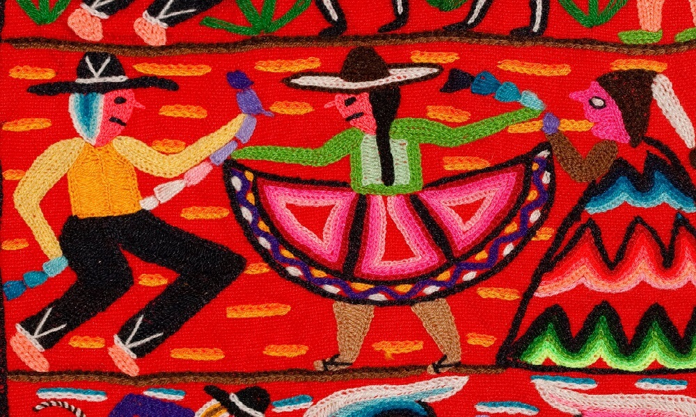 Section of colorful embroidered wall hanging