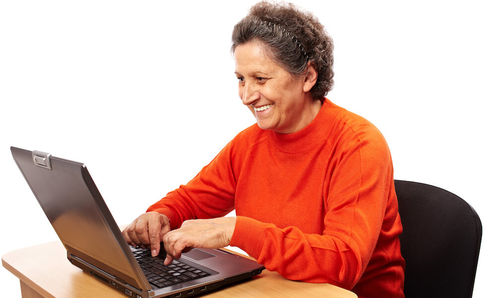 Senior woman learning to use the computer