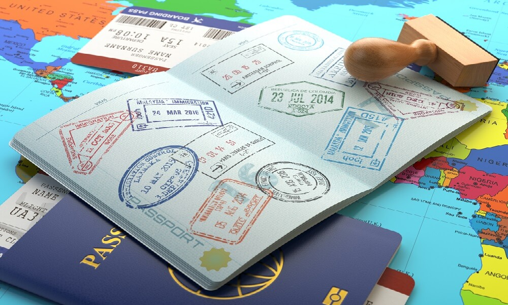 Opened passport with visa stamps and boarding pass