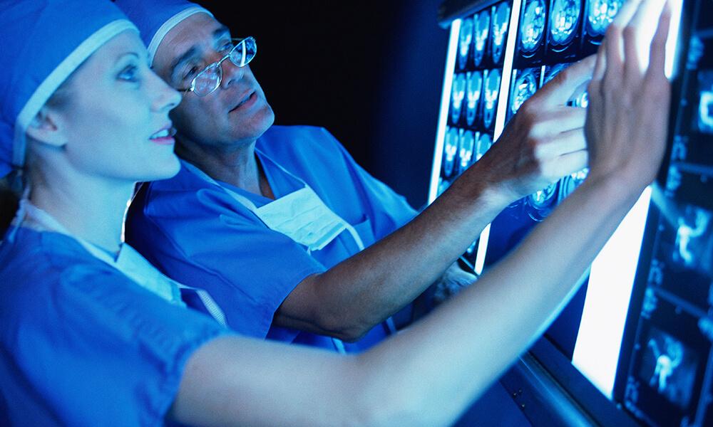 Doctors examining x-rays