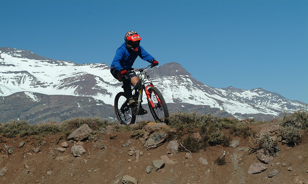 Boy mountain biking in Chile