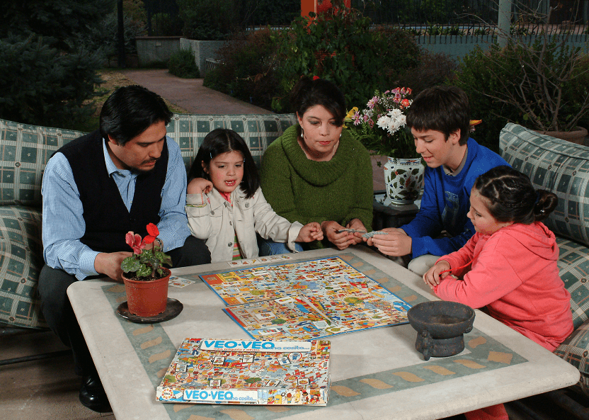 Chilean family playing board game
